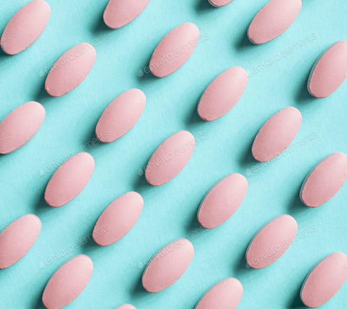 pink pills on blue background