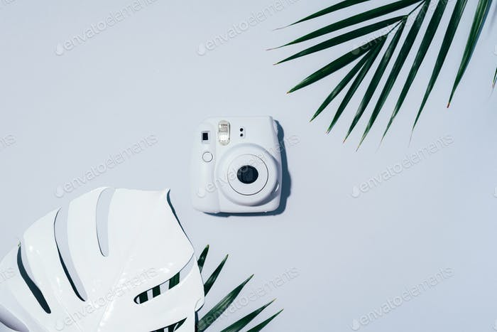 Vilnius, Lithuania - September 16, 2019: FUJIFILM INSTAX Mini Instant Film Camera on grey background