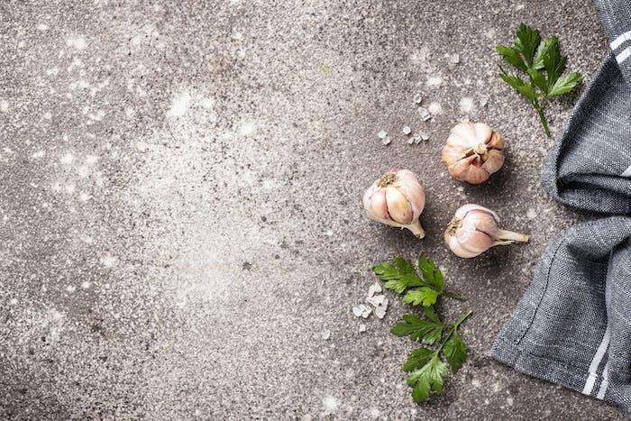 Fresh garlic on gray background