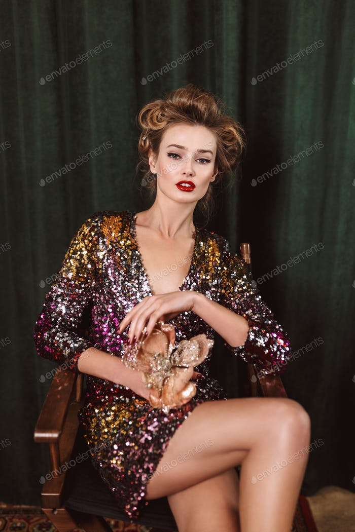 Young gorgeous lady with wavy hairstyle and red lips in bright d