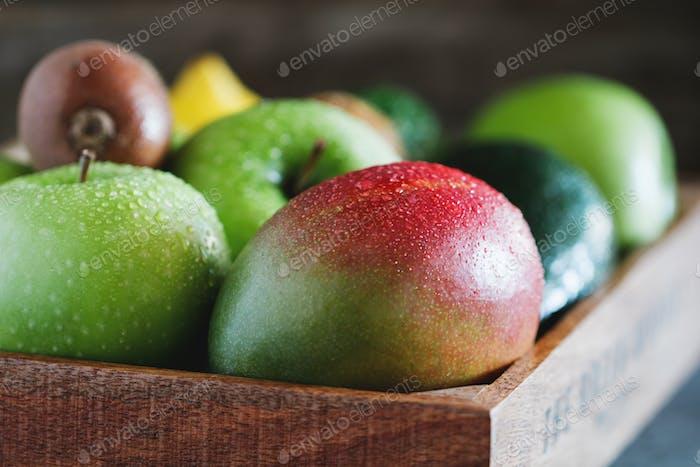 Wet fresh green fruit and vegetables