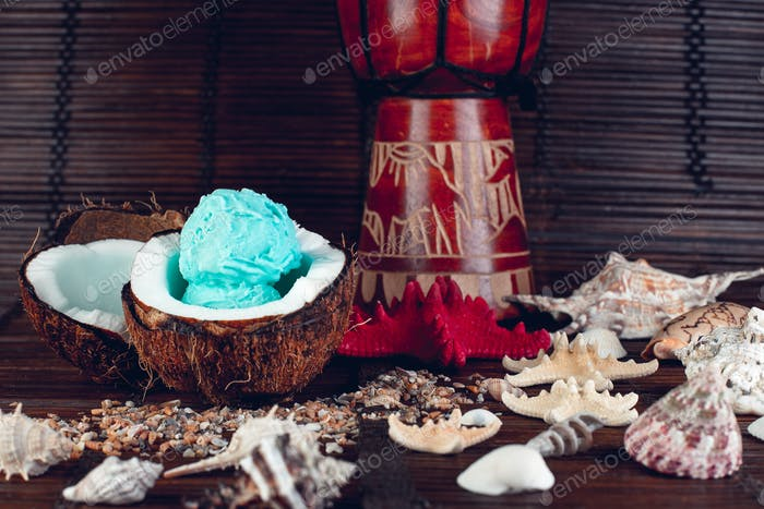 Blue ice cream in coconut bowl.