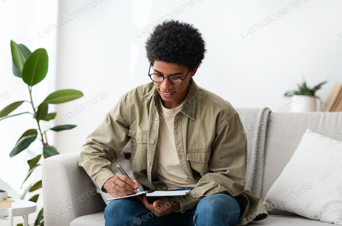 Distance education. African American teen university student studying from home at times of lockdown