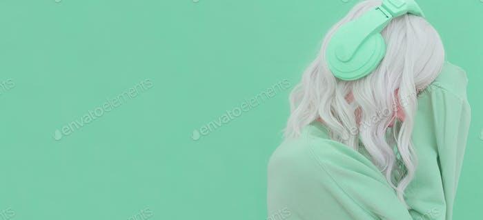 Vanilla Dj Blonde Girl. Headphones Party style. Fresh aesthetic mint colours. Listen to light music