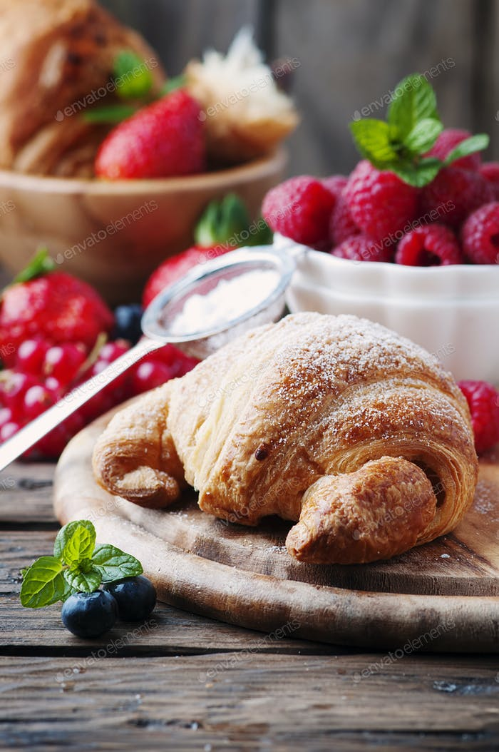 Fresh croissant with mix of berry