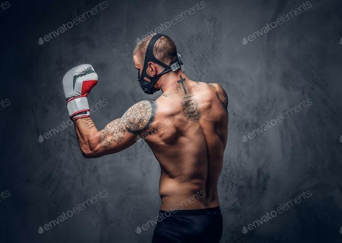 Fighter male over grey vignette background.