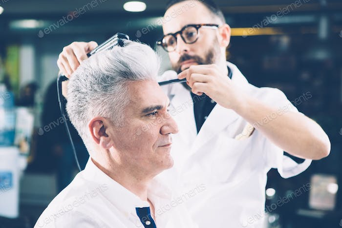 Barber styling a hairdo