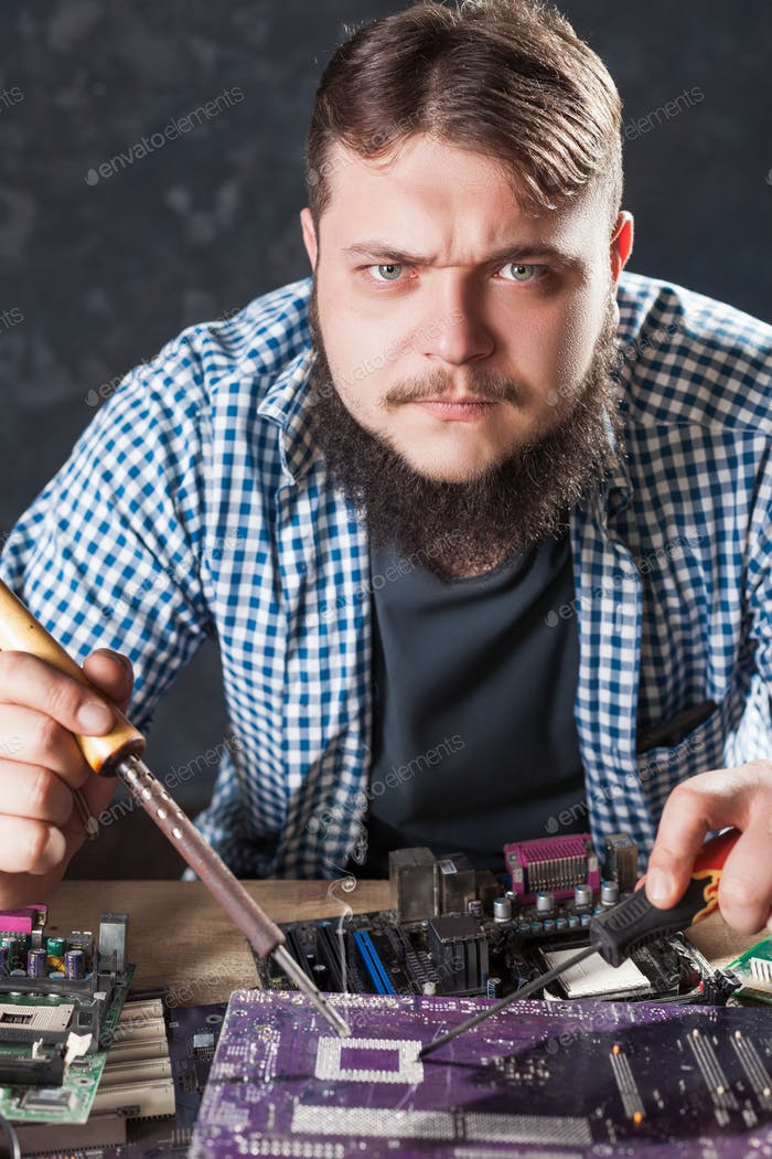 Repairman fixing problem with soldering tool