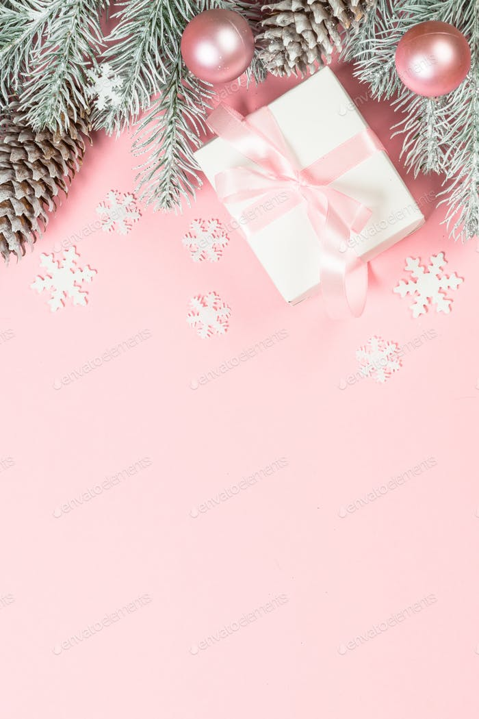 Christmas flat lay background with christmas present box on pink