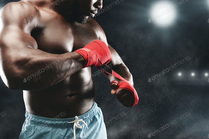 Close up of fighter on boxing ring wrapping fists