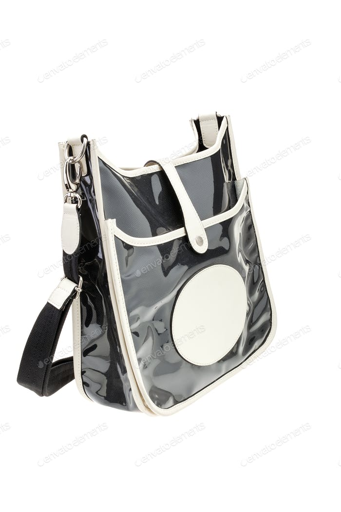 Black glossy womens bag isolated on white background.