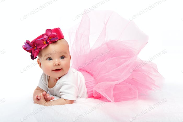 happy beautiful baby girl with pink hat on head
