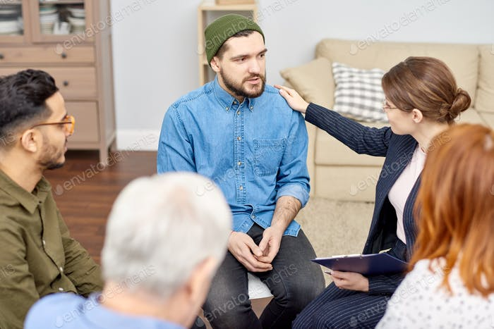 Encouraging Depressed Patient at Group Therapy Session