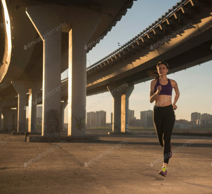 Female Athlete  Running in the city
