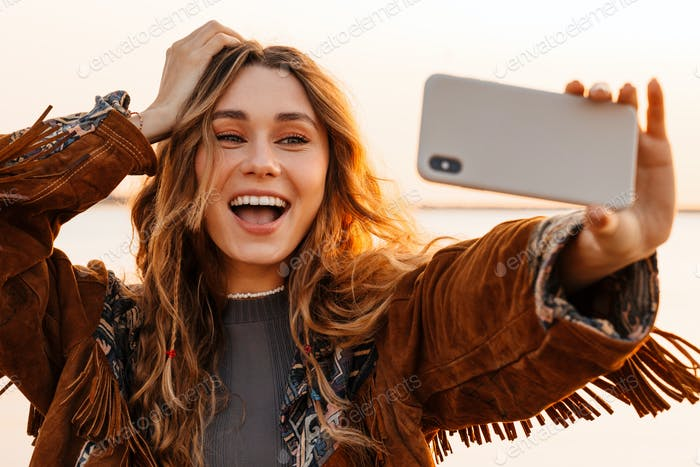 Woman taking a selfie by smartphone