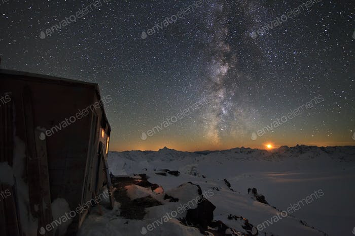 Milky Way and a house in the mountains