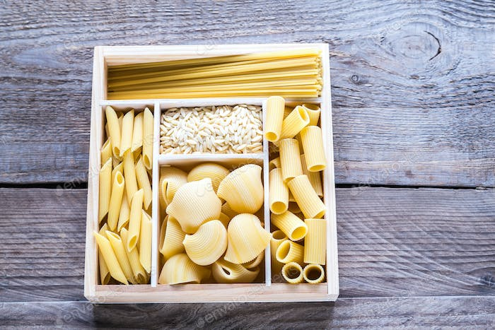 Various types of pasta in the wooden container