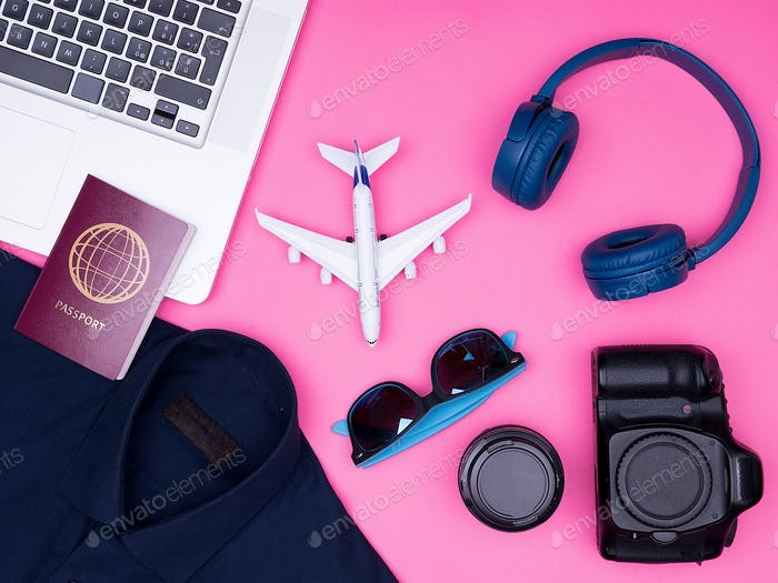 flat lay top view of traveler photographer accessories on pink background