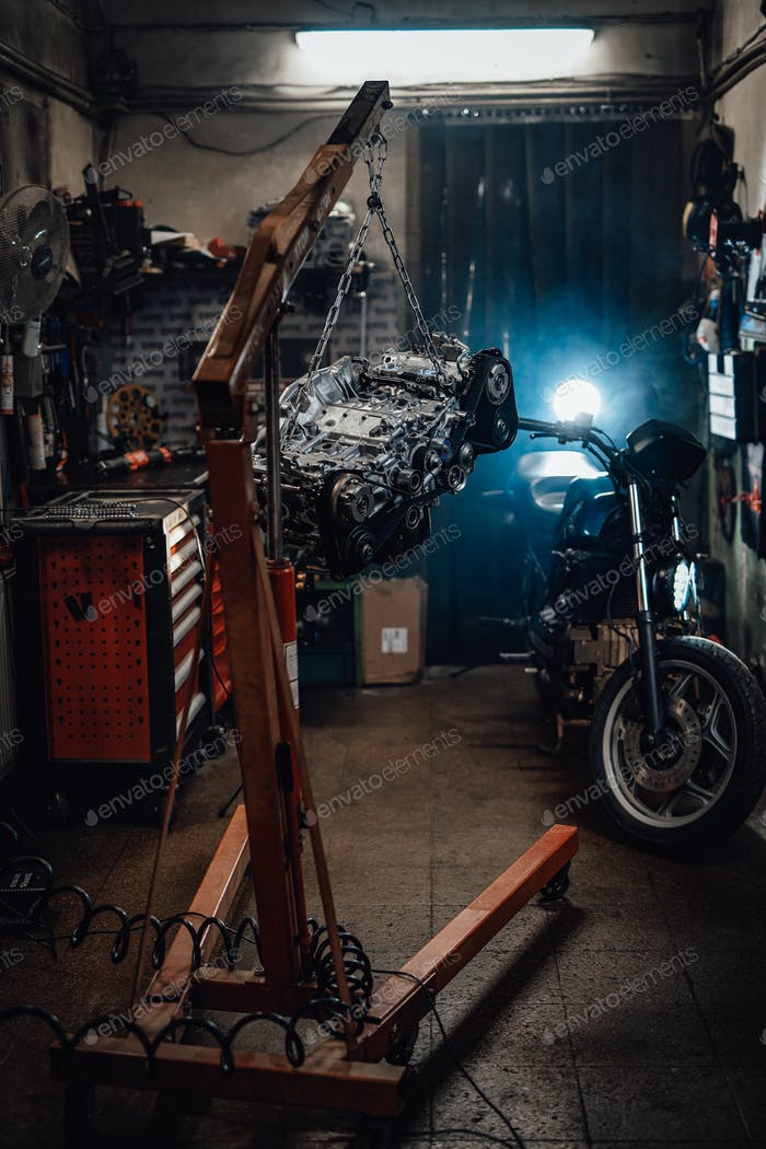 Suspended boxer engine, naked sportbike in dark garage or workshop