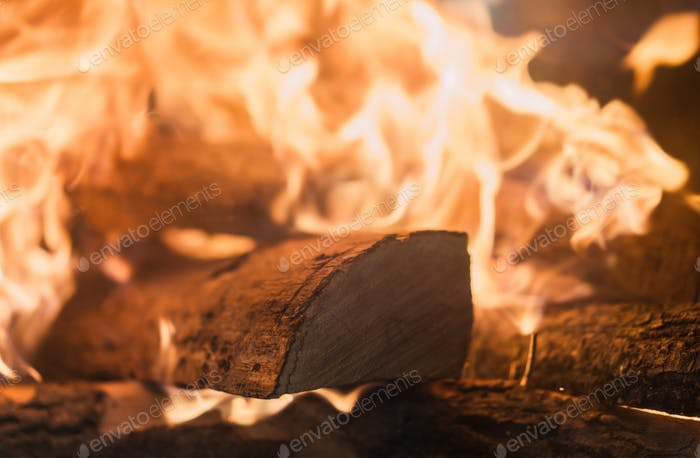 Logs on fire in a home fireplace
