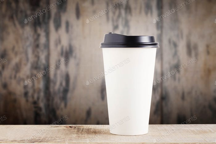 Paper cup on wooden