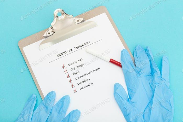 Checklist On Clipboard  with COVID-19 symptoms