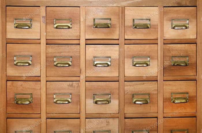 Cabinet with rows of small wooden drawers