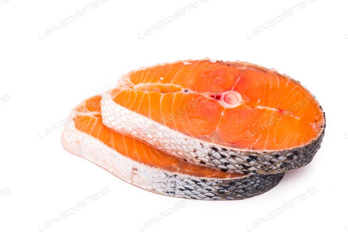 Freshly cut cross-section of salmon blocks on white background