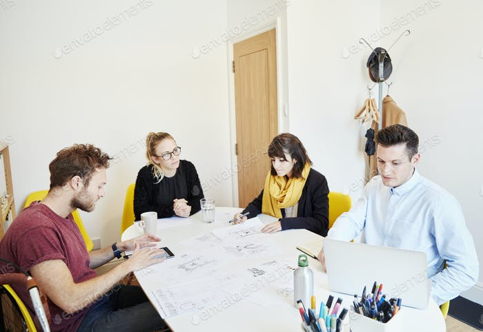 Four people at a business meeting