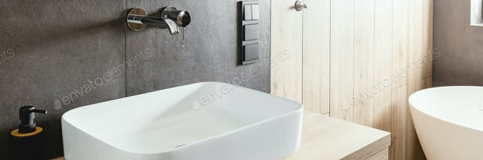 Double sinks in elegant white, concrete and wooden bathroom interior