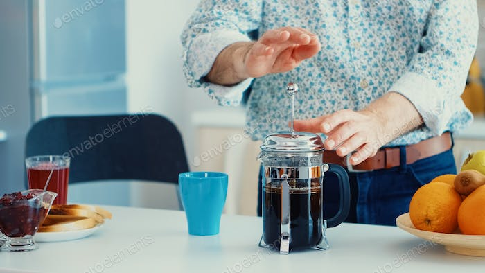 Making coffee in french press