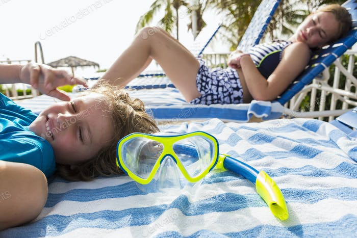 snorkel face mask with children in the background