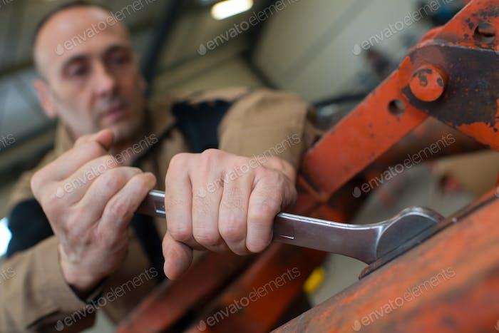 mechanic man using a wrench