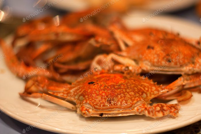 Cooked crabs on plate close