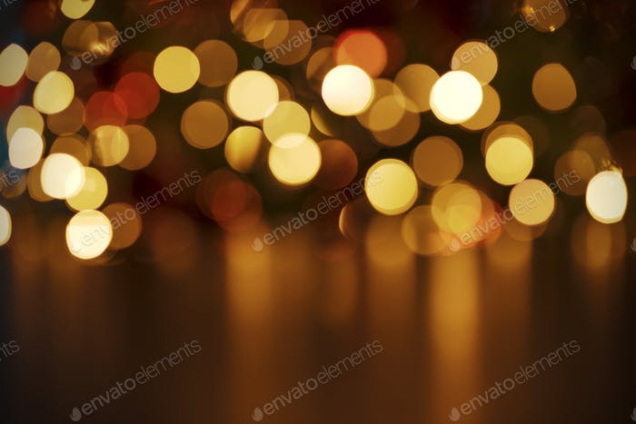 Christmas lights background with golden bokeh