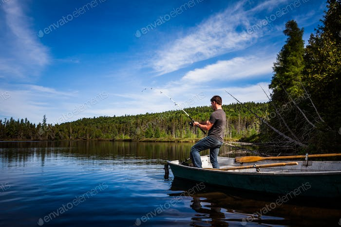 Young Adult Fishing trout in a calm Lake