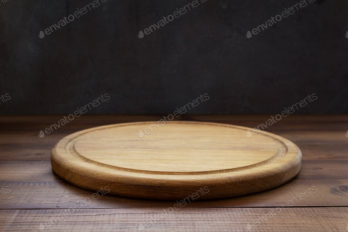 pizza cutting board at wooden table