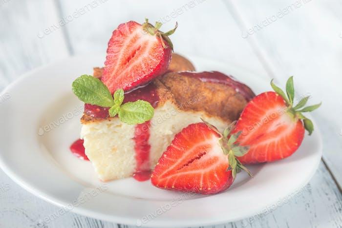 Slice of cheesecake with fresh strawberries