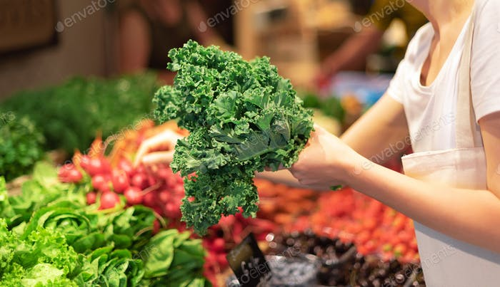 Zero waste, plastic free concept. Sustainable lifestyle. Woman chooses fruits and vegetables at