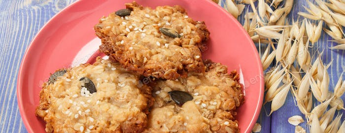 Fresh baked oatmeal cookies and ears of oat, healthy dessert concept