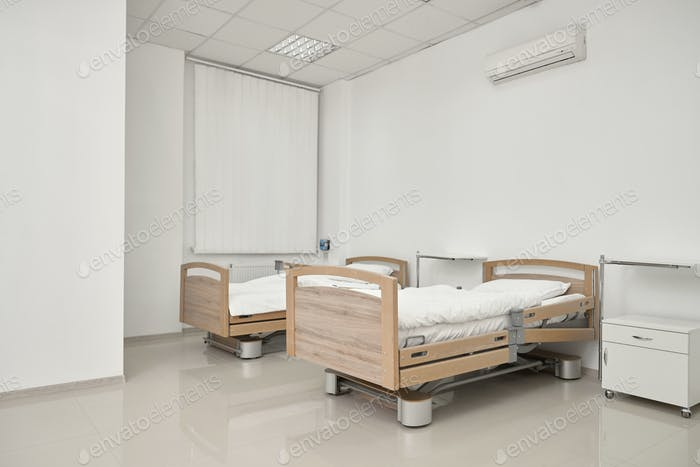 Two couches in spacious hospital room
