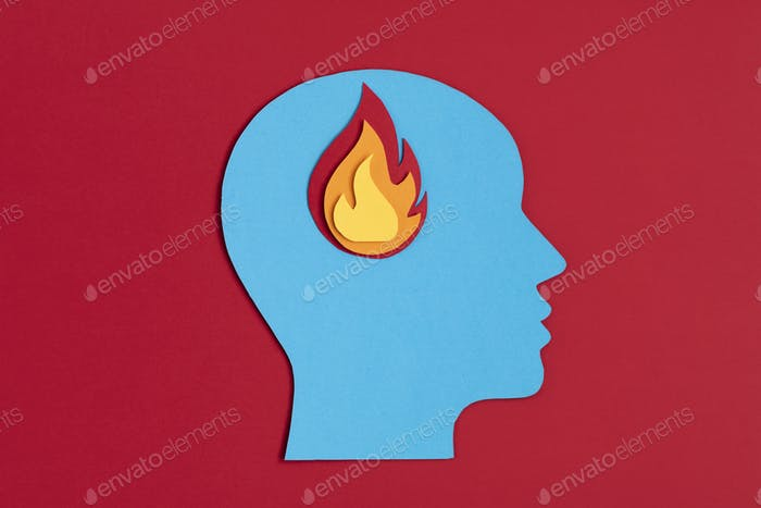 Papercut head with fire inside. Mental health problems, burnout, psychology, stress, mental illness