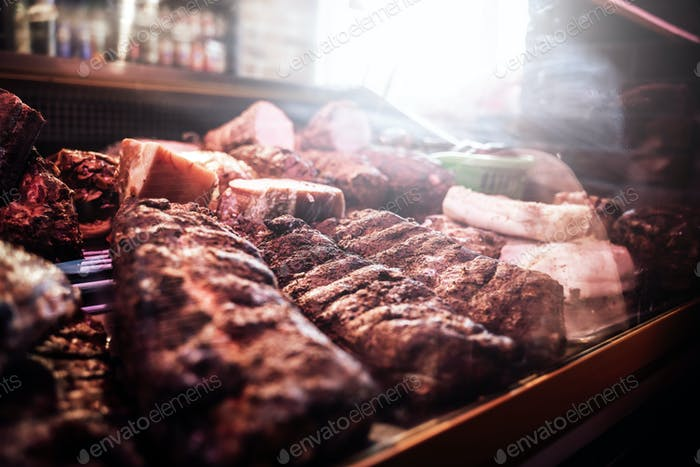 Fresh smoked meat in butcher shop's counter