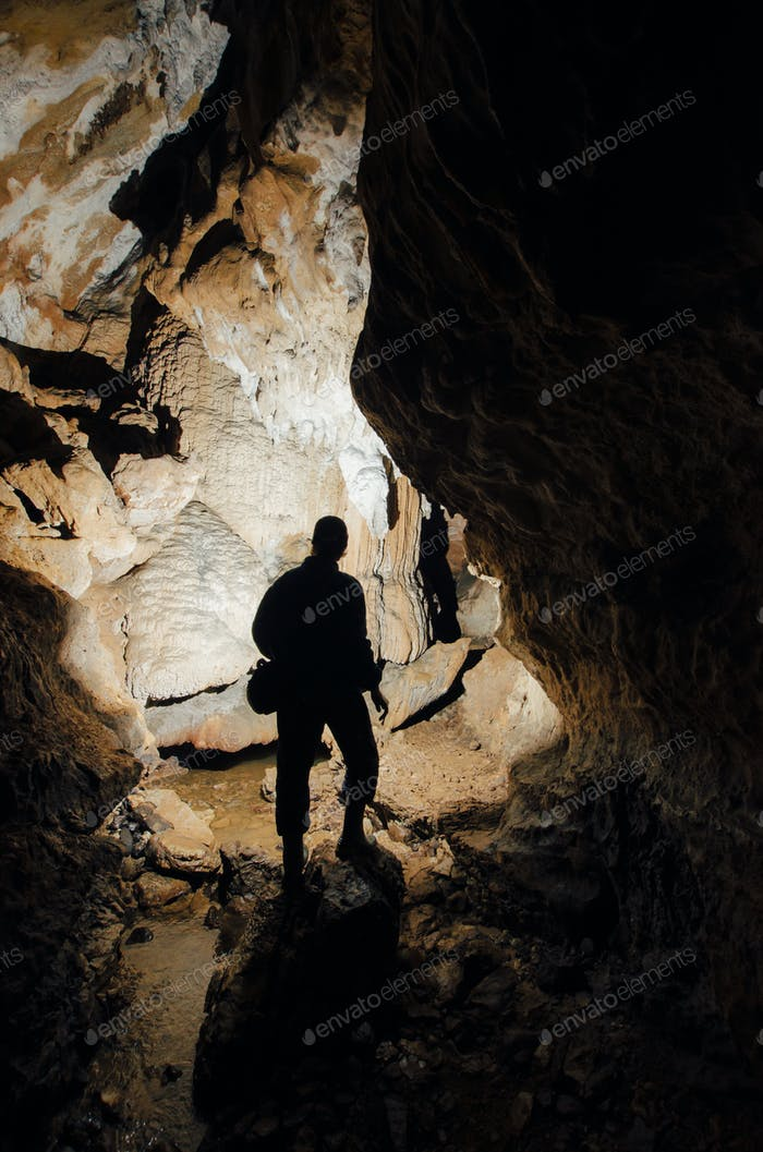 Man in dark cave