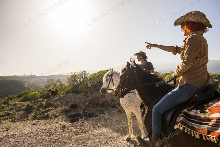 couple in vacation riding horses