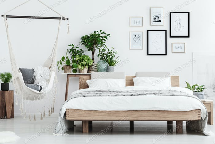 Natural bedroom interior with plants