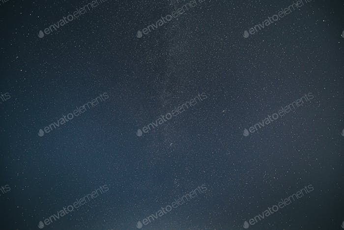 Real Night Sky Stars With Milky Way Galaxy. Natural Starry Sky Blue Background