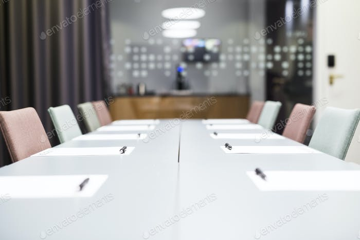 Papers and pen on conference table in office