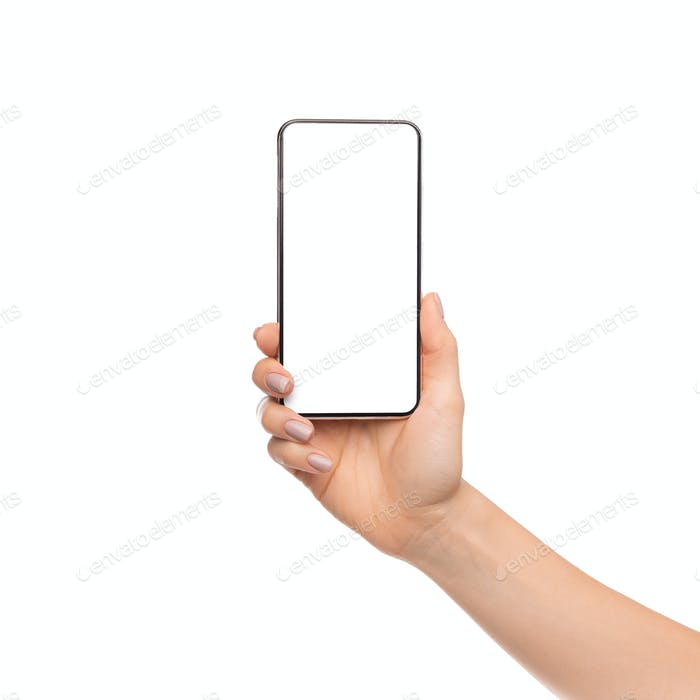 Woman's hand holding cellphone with big blank screen