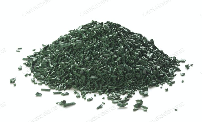 Spirulina Flakes Over White Background
